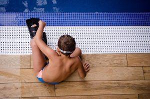 little boy swimming