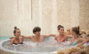 teens soaking in hot tub